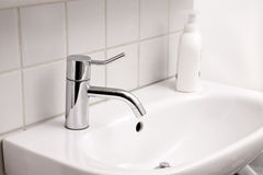 Tap Water. Close up of sink and tap in bathroom Royalty Free Stock Photos
