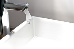 Tap water. Modern Chrome Faucet starting to pouring water Stock Images
