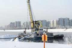 The tap water on the ship. Construction crane stands on the river Royalty Free Stock Photos