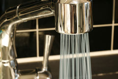 Tap with a water stream Royalty Free Stock Photo