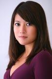 Tapa asiática de la púrpura de la mujer Fotos de archivo