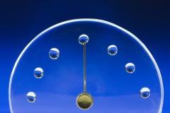 Tapa del reloj con gota del agua Imagen de archivo libre de regalías