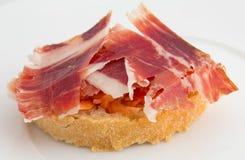 Tapa, jambon et tomate espagnols Photos stock