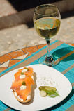 Tapa with white wine Royalty Free Stock Photo