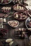 Tapas appetizers on wooden table. Vintage effect stock photo