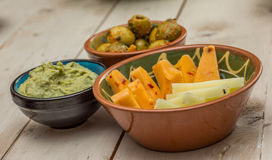 Tapas with assorted cheese, olives, humus Stock Images
