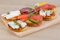 Tapas with cheese, salami and salmon Stock Image