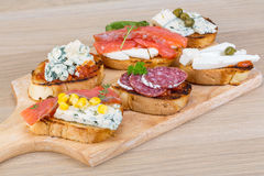 Tapas with cheese, salami and salmon Stock Images