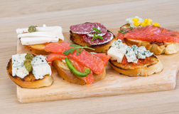 Tapas with cheese, salami and salmon Royalty Free Stock Image