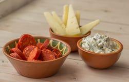 Tapas, chorizo, manchego cheese and tzatziki Royalty Free Stock Photo