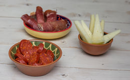 Tapas, chorizo, manchego, and cured ham Stock Images