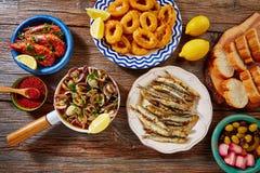 Tapas clams shrimps calamari fried anchovies Stock Photos