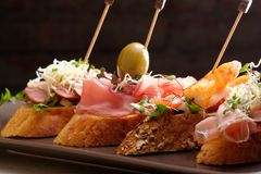 Tapas on Crusty Bread Royalty Free Stock Photos