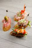 Tapas on Crusty Bread Royalty Free Stock Images