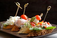 Tapas on Crusty Bread. Selection of Spanish tapas served on a sliced baguette Stock Photo