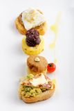Tapas on Crusty Bread - Selection of Spanish tapas Royalty Free Stock Image