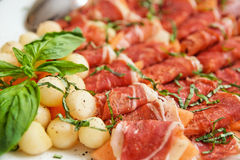 Tapas with cured ham, basil and melon balls Royalty Free Stock Photography