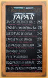 Tapas of the day on blackboard in Sevilla. Tapas of the day on the blackboard of a restaurant in Sevilla Stock Photo
