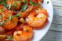 Tapas de pinchos de crevette d'ail d'Espagne Photo stock