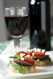 Tapas del fungo di Shitake e vino rosso Fotografie Stock