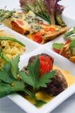 Tapas dishes. Mixed tapas on white background Stock Photography