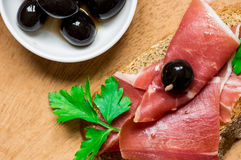 Tapas with jamon and olives Royalty Free Stock Images