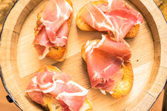 Tapas with jamon on a wooden barrel Royalty Free Stock Image