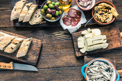 Tapas on kitchen table, from overhead, copy space Royalty Free Stock Photos