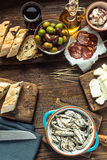 Tapas on kitchen table, from overhead, copy space Royalty Free Stock Image