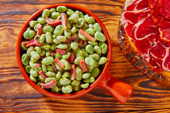 Tapas lima beans with iberico ham from Spain Royalty Free Stock Photo