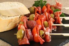 Tapas meat olive and tomato Royalty Free Stock Image