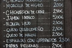 Tapas menu. Restaurant menu in Spanish - outdoor tapas bar in Seville, Spain Stock Photography