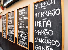 Tapas menu, seafood, restaurant. Blackboard fresh fish restaurant with menu of the day, fried fish, seafood, shrimp, Andalusia, Spain, Southern Europe Royalty Free Stock Photography