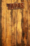 Tapas menu. Tapas signboard nailed to a wooden wall Royalty Free Stock Photography