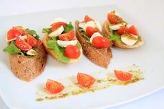 Tapas with mozzarella and cherry tomatoes Stock Image