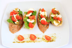 Tapas with mozzarella and tomatoes Royalty Free Stock Photography