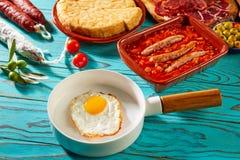 Tapas pisto con tomate ratatouille egg sausage. Tapas pisto con tomate ratatouille egg and sausage from Spain Stock Image