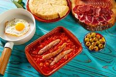 Tapas pisto con tomate ratatouille egg sausage. Tapas pisto con tomate ratatouille egg and sausage from Spain Royalty Free Stock Photo