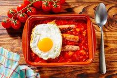 Tapas pisto con tomate ratatouille sausage egg. Tapas pisto con tomate ratatouille egg and sausage from Spain Royalty Free Stock Photo