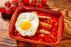 Tapas pisto con tomate ratatouille sausage egg. Tapas pisto con tomate ratatouille egg and sausage from Spain Royalty Free Stock Images