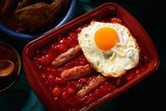 Tapas pisto con tomate ratatouille sausage egg. Tapas pisto con tomate ratatouille egg and sausage from Spain Stock Images