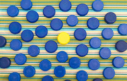 Tapas plásticas, una en un diverso color Imagen de archivo libre de regalías