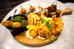 Tapas Platter. A delicious and sumptuous tapa meal platter. The meal is comprised of crispy pork chop, deep fried squid, deep fried fish, toasted breads on Stock Photos