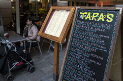 Tapas restaurant Barcelona, Spain. Tapas restaurant and chalkboard menu located in Barcelona, Spain Stock Image