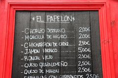 Tapas restaurant menu. SEVILLE, SPAIN - NOVEMBER 3, 2012: Spanish restaurant blackboard menu in Seville, Spain. Seville is a major tourism destination in Spain Royalty Free Stock Image