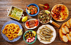 Tapas seafood clams shrimps calamari anchovies stock photo