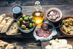 Tapas served in restaurant or bar on wooden table Royalty Free Stock Images