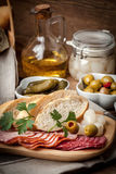 Tapas with sliced sausage, salami, olives, marinated onions, cuc Royalty Free Stock Image