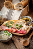 Tapas with sliced sausage, salami, olives, marinated onions, cuc Royalty Free Stock Photos