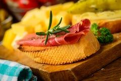 Tapas snack closeup. Still life with spanish tapas snack and serrano ham Stock Photography